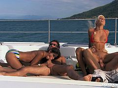 Slim bitches Boroka Balls and Sahara Knite are having fun with two men on a yacht. The girls try hard to please the dudes. They suck their cocks ardently and then allow the guys to fuck their vags and butts.