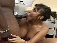 In order to drink his warm fresh sperm, this slut with big fake tits and shaved pussy let some black dude fuck her in hardcore style what she likes mostly