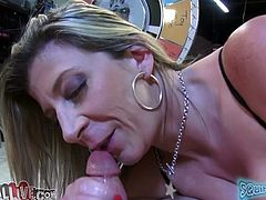 First she sucks that hard cock and makes it slimy before she place that thing between her big melons, that horny fucker is ready for her cunt.