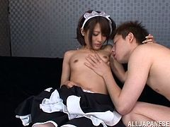 Sweet Yuuki is wearing her very sexy maid costume. She stays with her legs spread and shows us her white panties, and how gently she rubs her pussy over them. Then, the cutie is kissed by this dude and gets her nipples sucked. After finishing with her nipples he goes down for her snatch and licks it up