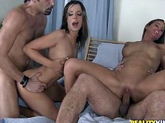 Slim hussy Debbie White and her pretty GF are having fun with two men indoors. The girls suck and rub the dudes' pricks ardently and then get fucked in cowgirl and other positions.