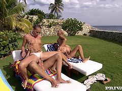 Jennifer Love and Kathy Campbel are playing dirty games with two dudes in the yard. The guys poke their schlongs into the chicks' mouth, pussies and butts and they all moan loudly with pleasure.