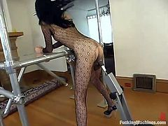 Nerdy brunette milf Sabrina wearing a bodystocking is having some good time indoors. She shows off her nice butt and small tits and then gets her coochie drilled by a fucking machine.