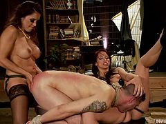 Francesca Le and her smoking hot friend Nicky Hunter are going to invade this dude's asshole with some huge strapons in bondage. Nothing is more painful!