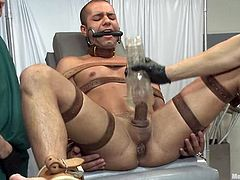 Carter West gets chained and tied up in a hospital. He gets his cock toyed with vibrators and then sucked by a man in a hospital gown.