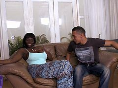 Curvaceous Black chick gets her juicy tits licked. After that she gives a blowjob and gets fucked rough on a sofa.