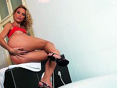 Blonde babe Summer Breeze with shaved pussy, miniskirt and natural tits masturbates with a vibrator in a bathroom with her soapy body.