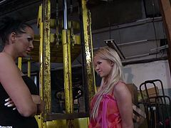Kinky blonde girl gets involved in filthy and dirty BDSM action. Mighty mistress ties blonde babe with her hands behind the back. She also lifts the girl up in the air so she is now hanging down the ceiling.