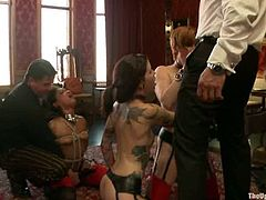 Krysta Kaos, Lilla Katt and one more girl get bound and humiliated by some lewd man. Then the dude pokes his prick into the girls' mouth and enjoys the way they moan.