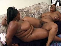 Fat ebony lesbian sluts China and Sweet Vanilla are masturbating with a dildo in their big fat pussies until they get full orgasm.
