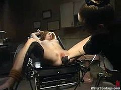 Tied up girl lies on a gynecological chair and gets her vagina drilled hard. Then she also gets fingered and tortured in a bathtub filled with ice cold water.