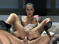 Busty dark-haired chick Mela allows her man to eat her pussy in a bathroom. Then she lets him fuck her pussy from behind and they have awesome anal sex on the floor.