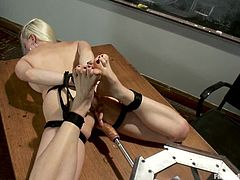 Slim and sexy blonde chick gets tied up by some dude right in the classroom. After that she gets her tight vagina toyed by the fucking machine in the guy.