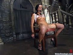 Charming brown-haired girl Melissa Lauren gets bound in a basement. Then somebody torments the girl and attaches weights to her pussy lips.
