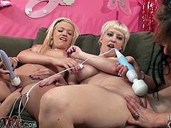 Wild lesbians with massive boobs pose for the camera and then have wild lesbian orgy. They toy pussies and asses with a strap-on and big dildos.