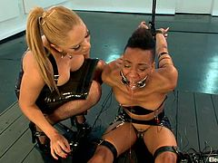 Skinny Black girl gets bound and tortured with electricity by Lea Lexis. After that Nikki also licks Lea's vagina and gets her nipples pinched with claws.