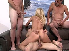This blonde whore needs at least three cocks to satisfy her lust. While one stud drills her fanny in sideways position slim nympho starts sucking the other cocks passionately.