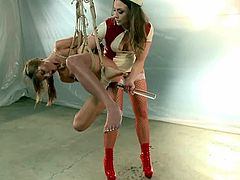 Cassandra Nix and Chanel Preston are getting naughty in a hospital ward. The slave gets bound and tormented and then enjoys having a fist in her snatch and forceps on her pussy lips.