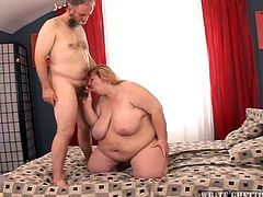 This big, fat blonde needs some cum in her pussy! She gets her huge boobs sucked and then, grabs the guy's hairy cock, to have a taste of it. The fucking whale swallows his hairy penis with delight and then, gets titfucked. After all that playing around, things get serious and he drills her bald fat pussy in sideways!