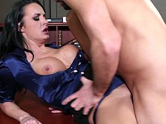 Torrid black haired busty MILF Alektra Blue takes fat cock up her shaved cunt missionary style. She gives some head and gets railed doggystyle over the table.