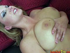Busty blonde milf Sara Stone gives an amazing titjob to her man and sucks his dick. Then she stands on all fours and they have some naughty doggy style banging.