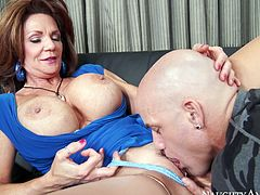 Astonishing mommy with giant hooters Deauxma kisses her bald lover and lets him polish her shaved pussy with his tongue.