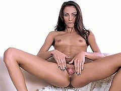 Turned on skinny brunette slut Celeste Star with natural titties and long legs in undies only polishes twat while teasing has fun while playing with gigantic rubber dildo.