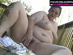 Fat ass bitch with huge natural boobs poses for cam on a terrace. She takes off her clothes exposing her plump body. Then she starts playing with her clam passionately.