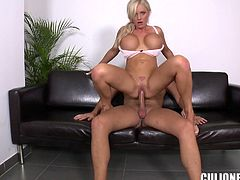 Busty blonde milf Jordan Pryce shows her huge fake boobs to some guy and licks his dick. Then she stands on all fours and allows the man to fuck her throbbing coochie doggy style.