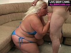 Dirty blonde hooker with giant boobs and damn fat ass is wearing blue bikini that barely fits her enormously fat body. She sucks hard dick greedily craving for cum. The guy gives her what she wants by shooting huge load on her big boobs.