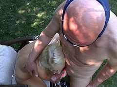 This bald man was trying to sell ice cream when he saw this hot young blonde sunbathing. She didn't want ice cream. She wanted his cock.
