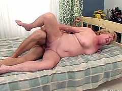 Cougar fat hoochie likes it hotter with younger dudes. She gets her ugly snatch fucked hard in doggy style position and in missionary one from behind.