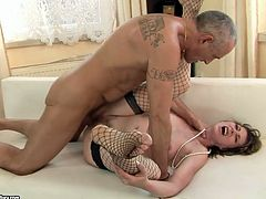 Mature harlot in sexy fishnet stockings gets fucked hard by her lover