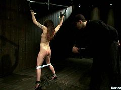 Whoever lured this girl, is a cruel creature. So Hona Li gets nailed on the floor with iron cuffs. Then her master spills some hot wax on her skin, making her stun out loud!