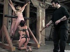 These three smoking hot babes are such a loyal sex slaves. Two of them are suspended and the third one licks their pussies, being tied up.