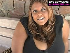 Though this ebony babe is fat as fuck she is still seductive woman with pretty face. She flirts with a white guy and later gives him a head.