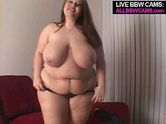Brownhead mom with big juicy jugs and ample ass is sitting on a couch in front of camera. She is wearing transparent lingerie that barely covers anything.