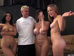 Our sluts are at a filming session. They're naked, horny and ready for the big screen, but more than that, the girls are ready for the guy's hard cock! They take position and the sexy brunette goes on top, to grind her pussy on the guy's face, while the other two suck his dick. Now that's how an orgy is done!