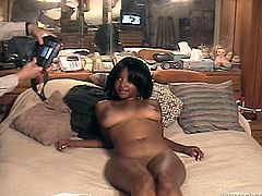 Booty black bitch is ready to serve white fat guy at the highest level. She shakes plump ass and spreads her legs wide open to expose pinkish vagina.