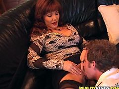 Lustful MILF lifts her skirt up and gets her vagina licked. After that she gives nice blowjob and gets fucked on a sofa.