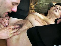 Lewd dark-haired granny Margo T. shows her hairy twat to some young dude and lets him play with it. Then the guy drives his shaft into Margo's hot depths and they have sex in side-by-side and other positions.