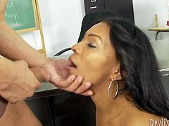 This ebony goddess knows what oral sex is all about. She takes her student's dick in her filthy mouth and sucks it greedily like mad. Then he fucks her hairy twat in doggy position.