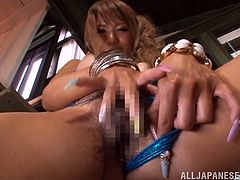 Sexy Asian slut is alone and she enjoys to rub and fingering her shaved vagina while she massage her big boobs at same time in this solo scene.