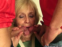 This granny just lost a bet involving football with two guys. She now has to handle both their cocks by using her mouth and her old fanny. She's good at what she does.