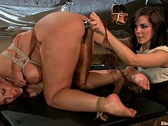 Curvaceous redhead girl gets tied up and whipped by Bobbi Starr. Later on Kelly also gets her ass stuffed with electro dildo.