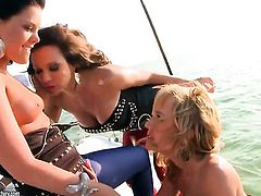 Check out Sandy, Blue Angel, and Madison Parker as they indulge in some hot lesbian threesome action on a yacht. Watch the images and the video of all the touching, kissing, caressing, followed by the cunt licking and fingering, and everything these hot bitches need for total satisfaction...