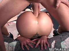 She loves spending a lovely sunny day, like this, outdoors. Further more, the sweet Asian chick likes sex! Well, she has the best from both, as two horny guys double penetrates her right there, in the open space. Look at them, stretching her anus and that delicious shaved pussy