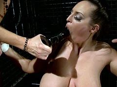 Nasty brunette hoe is a big fan of bad BDSM sex games. So she gets tied up having no chance to move. Her mistress makes her suck huge black dildo.