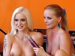 Silvia Saint doing lewd things with Stacy Silver in girl-on-girl action