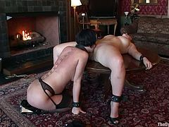 Two hot babes in stockings and high heels make an amazing show for their master. They toy each others pussies and asses with strap-on.